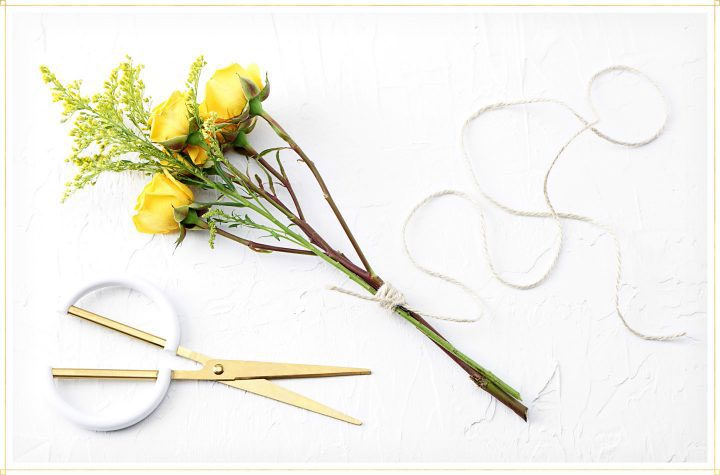 drying flowers step 2 - use string to tie bouquet together.